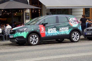 Malmo, Sweden - July 22, 2019: Promotion car for Swedish Big Slap Festival advertising DJ's Armin van Buuren and David Guetta, parked by the side of the road. nobody in de vehicle.