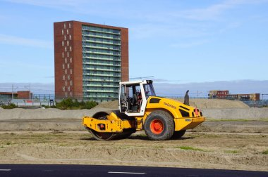 Almere Poort, the Netherland - September 20, 2019: Vibratory roller of Dutch construction company Heijmans on a construction site.