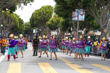 San Francisco, CA - May 26, 2019: Unidentified participants in the 41st annual Carnaval Grand parade in the Mission District, this year dedicated to the theme La Culture Cura, meaning, Culture Heals.