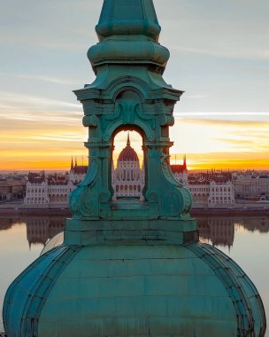 Unique photo about the Hungarian Parliament building through a church belltower. Amazing morning mood.