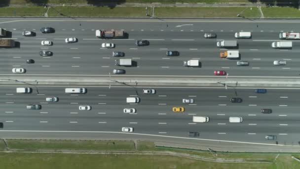 cars on highway in city in sunny summer day