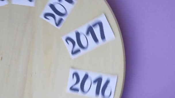 Years from 2014 to 2024 text rotating on wooden board and stopped on 2021 year, new year, time is running,