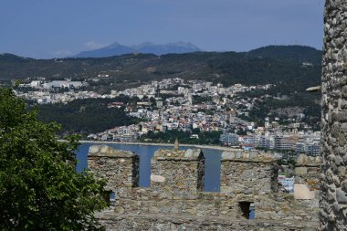 Kavala, Greece - June 11,2018: View from medieval castle with battlements to the city on Aegean sea