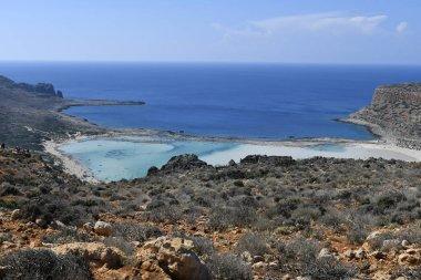 Greece, unidentified people enjoy the stunning beach of Balos on Gramvousa peninsula near Kissamos