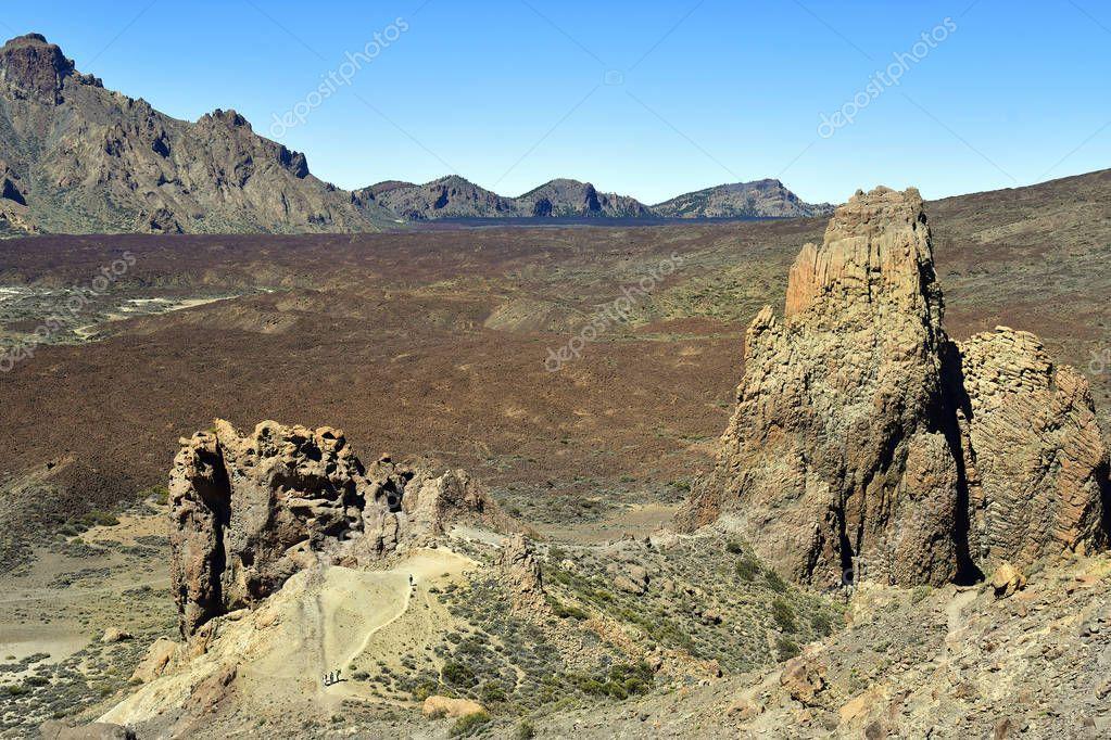 Spain, Canary Islands, Tenerife, people trekking in dry landscape named Llano Ucanca in Teide national park