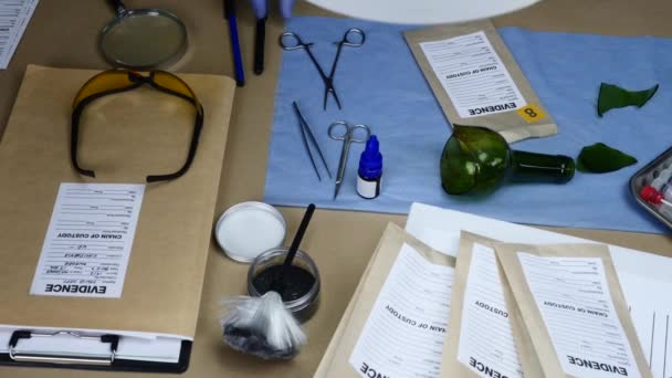 Scientific police officer examining evidence bags labeled in ballistic laboratory