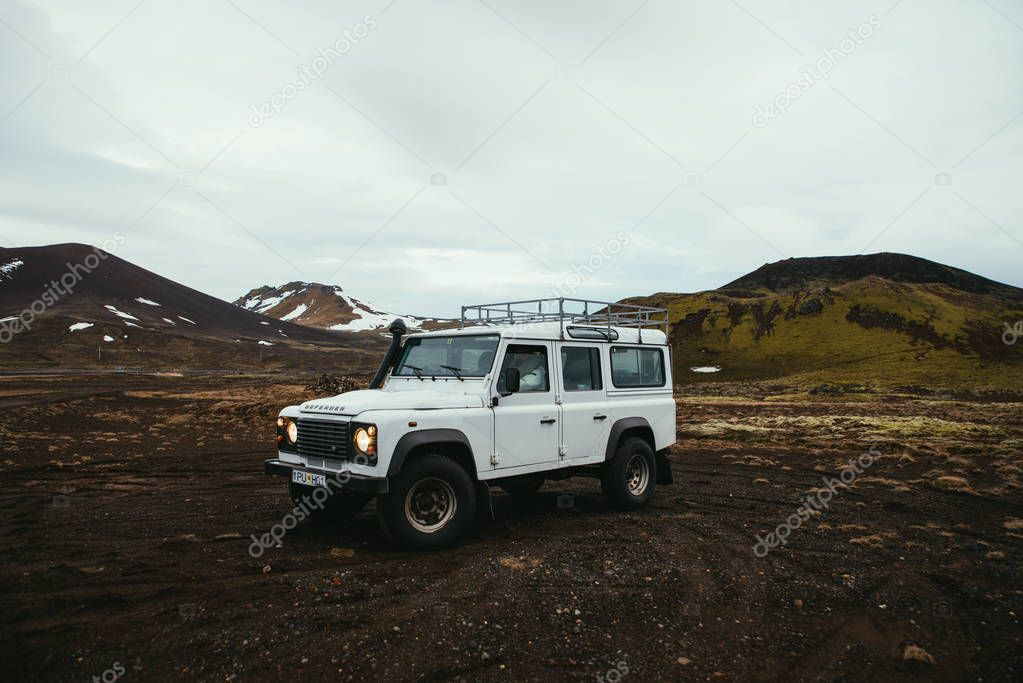 ICELAND, KIRKJUFELL, 16TH APRIL 2018. The land Rover defender parked in front the kirkjufell. The Defender  is a four-wheel drive off-road vehicle developed in the 1980s
