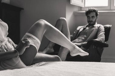 Couple at home, woman undresses for her man