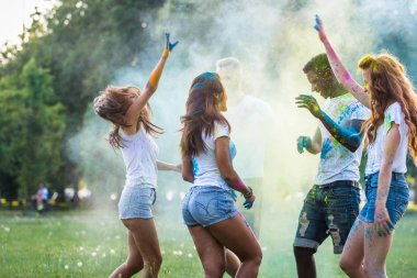 Group of happy friends playing with holi colors in a park - Young adults having fun at a holi festival, concepts about fun, fun and young generation stock vector