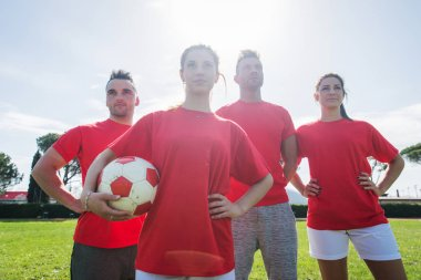Football players training in soccer field, concepts about teamwork and sport