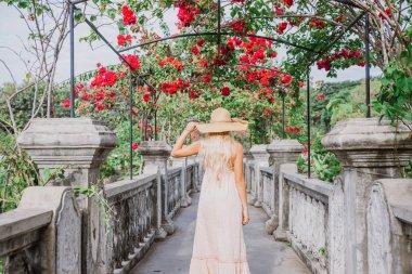 Beautiful caucasian girl visiting the water palace in Bali
