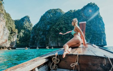 Beautiful woman making an excursion to phi phi island and maya b
