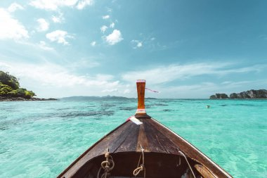 Long tail boat front with beautiful clear sea of thailand