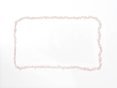 Valentine's Day background made by rose quartz crystal necklace that is shaped as a rectangle. Suitable also for as a Mother's Day background.