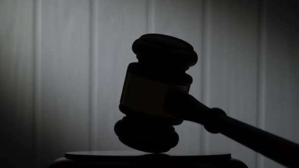 Silhouettes of a legal hammer.