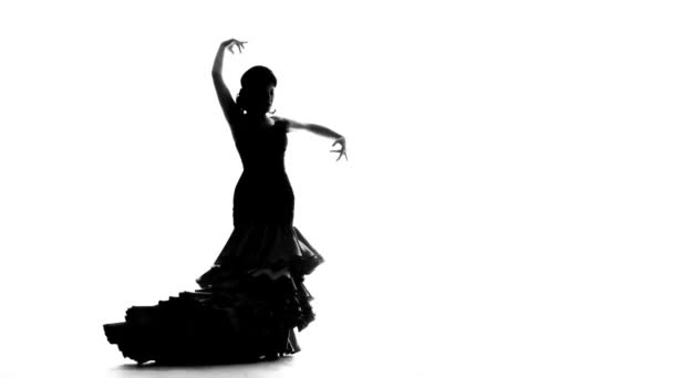 Dancer turns in an incendiary dance. White background. Silhouette