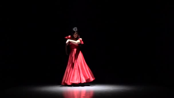 Flamenco. Dancer performs elegant movements with her hands in sexual dance. Black background. Slow motion