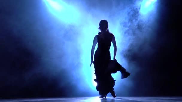 Silhouette Flamenco Dance. Blue background. Slow motion