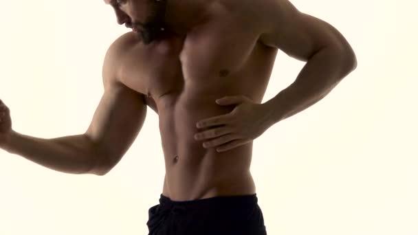 Man erotically dances . White background