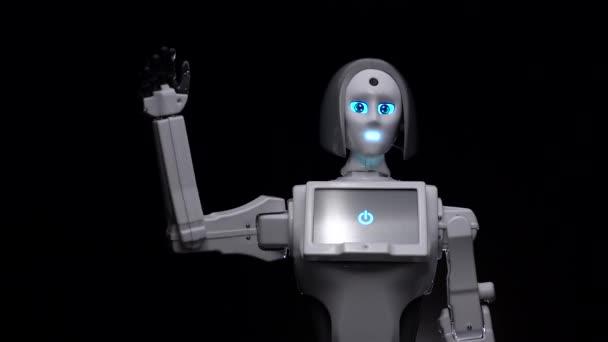 Ruka robota mává hello. Černé pozadí