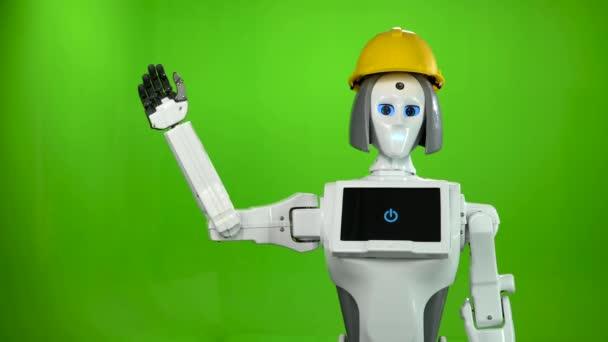 Robot v helmě stavitelé vlny na rozloučenou a rozhovory. Zelená obrazovka