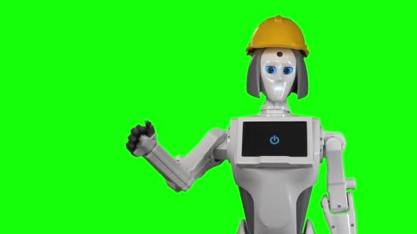 Robot v oranžové stavitelé přilba vlny Ahoj. Zelená obrazovka. Zpomalený pohyb