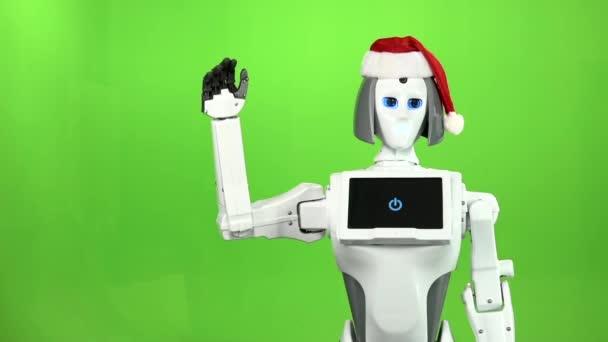 Robot v čepici Santa mává Ahoj. Zelená obrazovka. Zpomalený pohyb