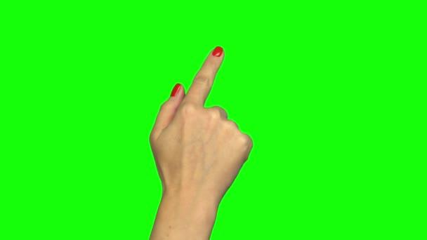 Izolované záběr ženské ruky na zelené obrazovce dělá gesta dotykové obrazovky