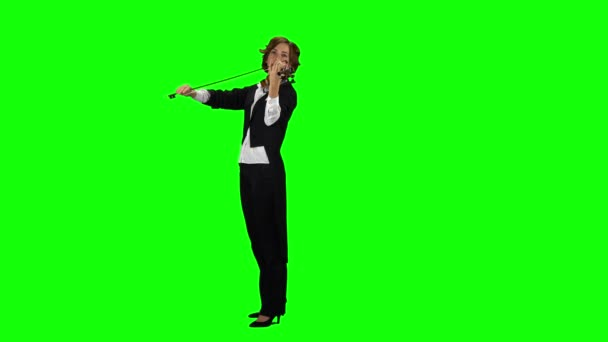 Zenész játszik a hegedű. Zöld képernyő