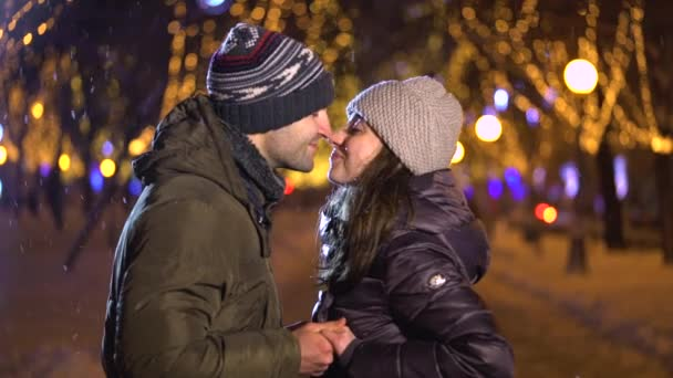 Happy romantic couple kissing at Christmas