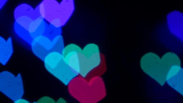 Szerelem háttér lila szív formák loopable. Lassított mozgás