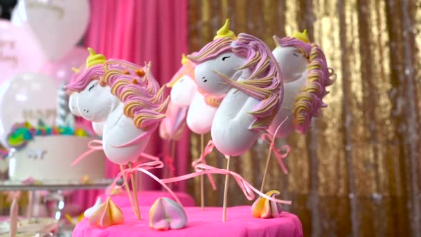 Childrens birthday party. Unicorn themed treats, against colorful background. Close-up