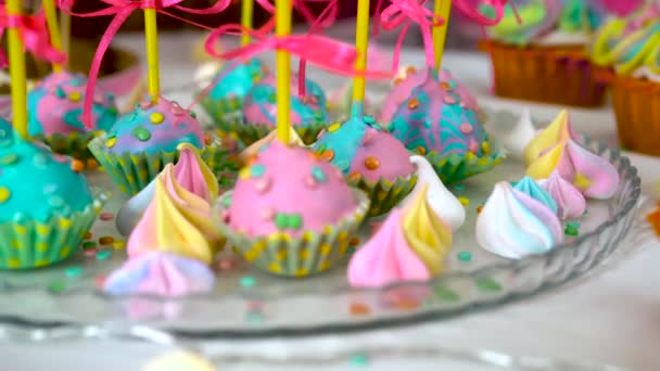 Childrens birthday party. Slow close-up motion of lollipops decorated with sweets