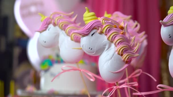 Unicorn themed treats, close-up against colorful background.