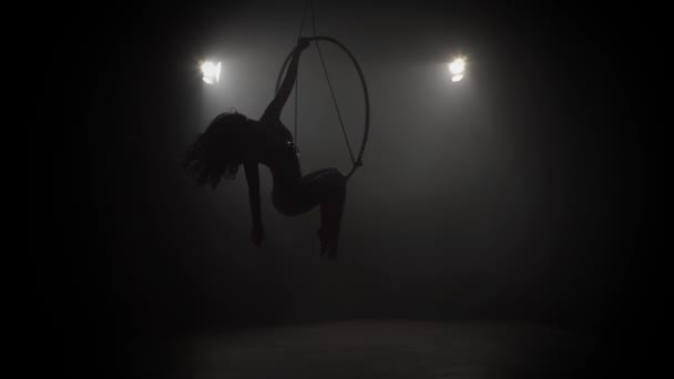 Young girl performs the acrobatic elements in the air ring 010