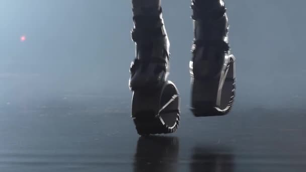 Close-up legs jumping in kangoo jumps shoes. Slow motion
