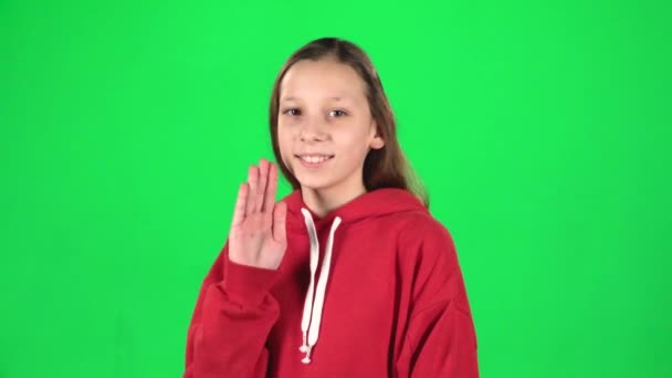 Cute girl is waving hello with her hands. Slow motion