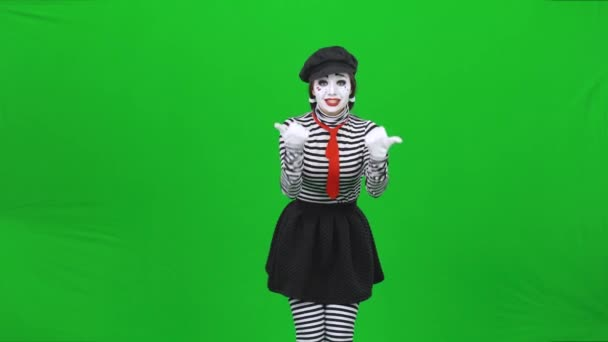 Mime girl is calling someone, smiling and gesticulating. Chroma key.