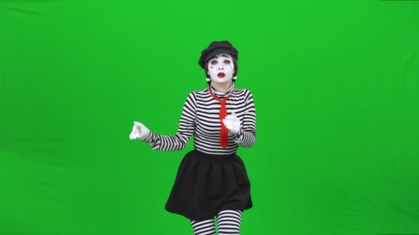 Mime girl acting like she skating on ice. Chroma key.