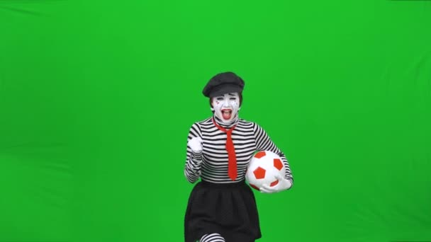 Mime girl is cheering on a football team. Chroma key.