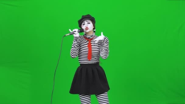 Mime girl singing a song in microphone, dancing. Chroma key.