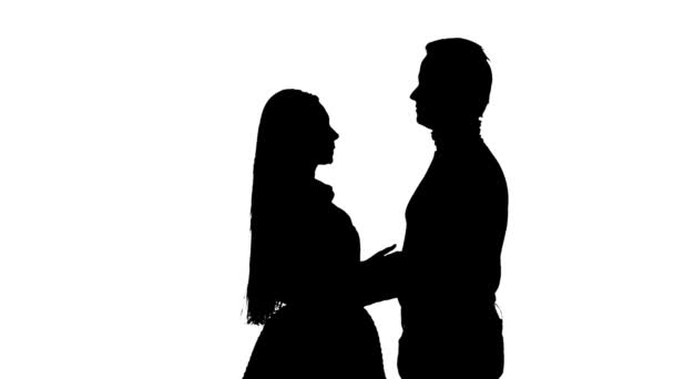 Loving couple hugs. White background. Silhouette. Slow motion