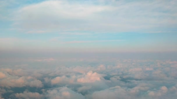 flying above clouds. skyline with horizon line visible and fluffy clouds