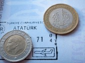 Photo turkish currency money few coins liras on airport arrival stamp at international foreign passport. Ataturk portrait and inscription visible. macro close-up image