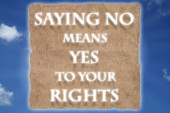 Saying No means Yes to your Rights text message in glowing white letters on rice paper. A blue sky with white clouds in the background.