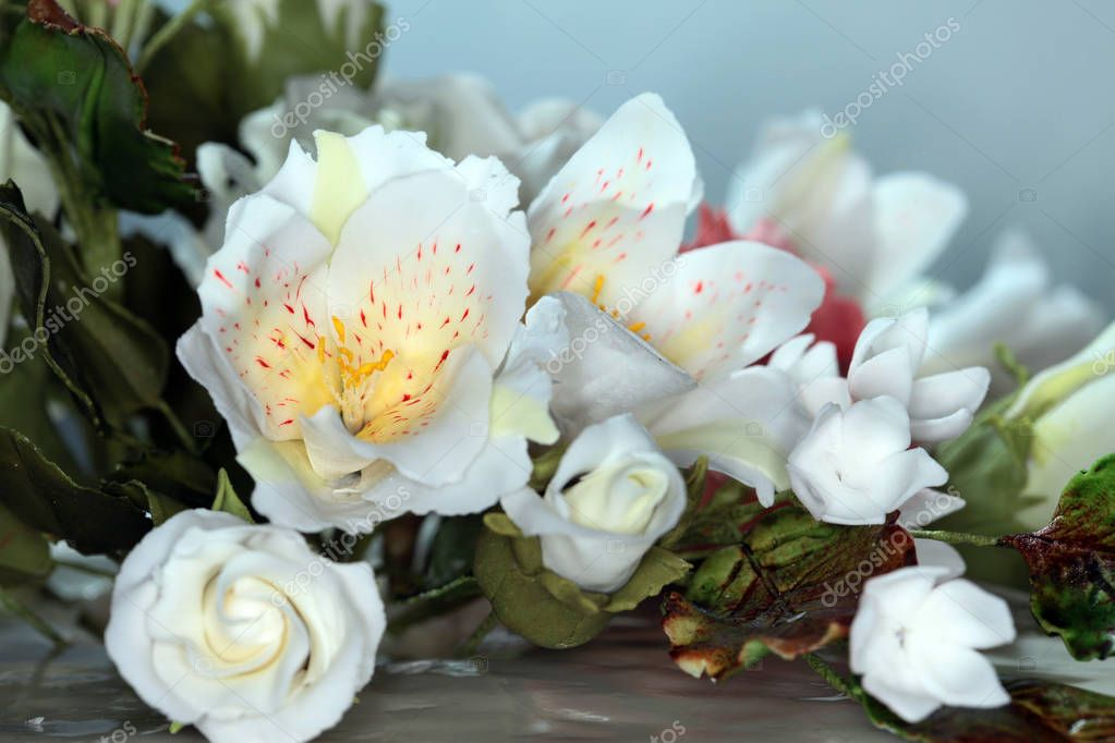 macro expertly made beautiful flowers on the cake on a light background studio
