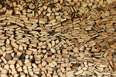 Close-up texture of a pile of wood logs and board