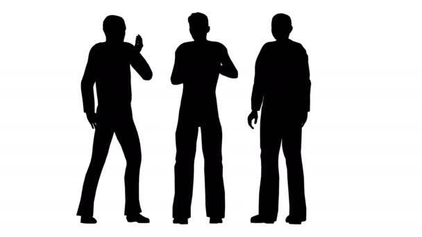 Silhouettes of three people stand and communicate.