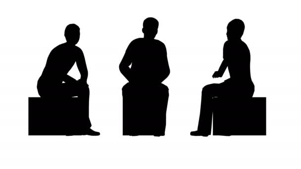 Silhouettes of three people sit and chat.