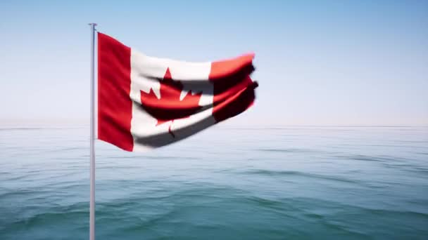 A large Canadian flag blows in the wind on a cloud free day.